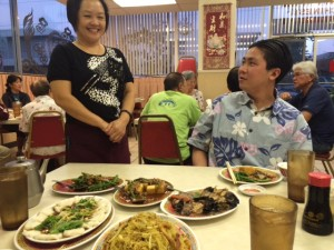 Duk Kee's owner Cammy talking food with Jackie's son, Ryan Oda, a realtor and Iolani graduate