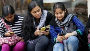 Mobile users in India/photo by BBC