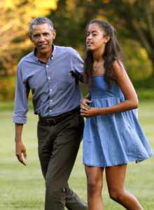 Malia and her father/photo Yuri Gripas Reuters