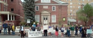 A regular Friday vigil held outside Homewood Friends Meeting in Baltimore
